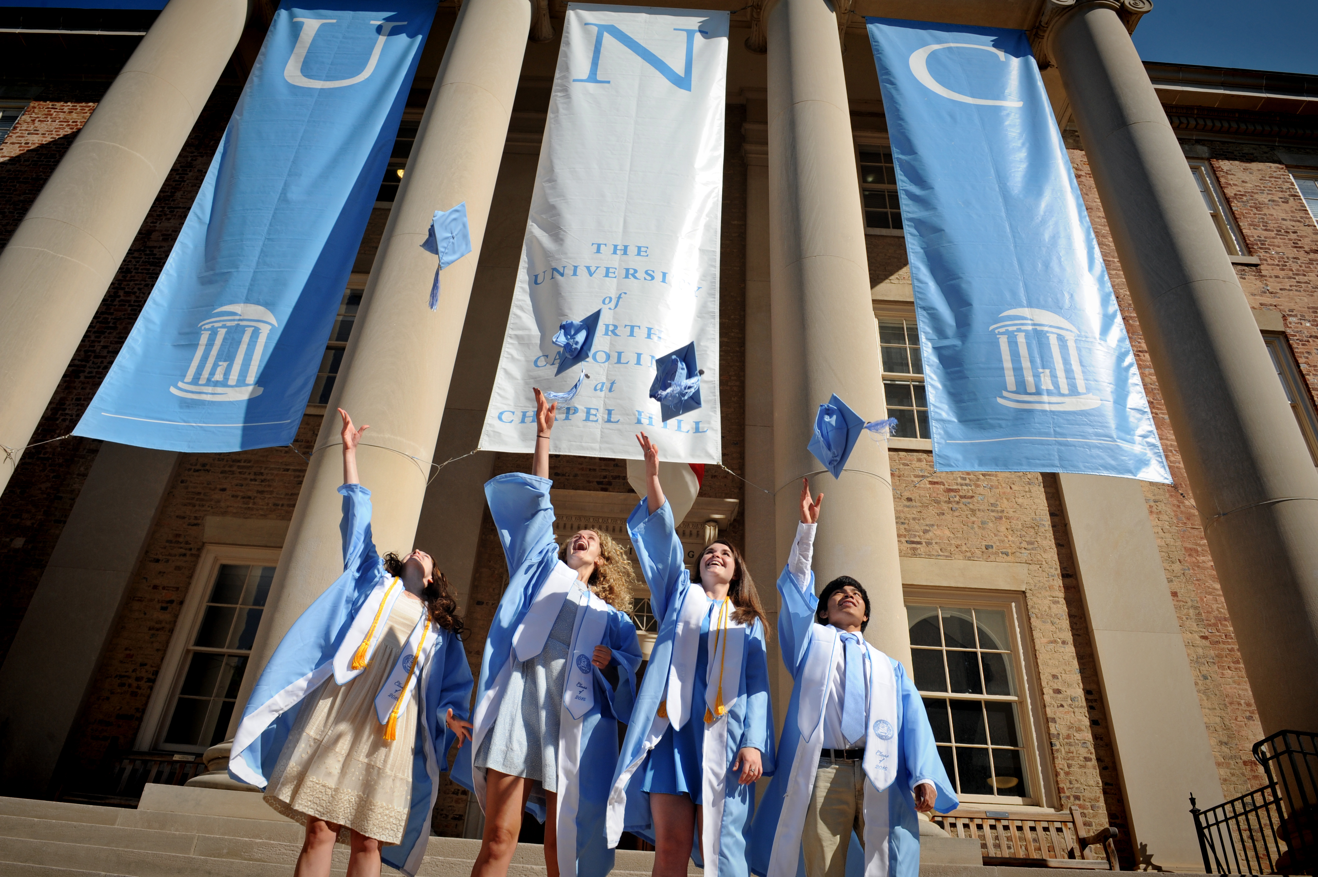 UNC Chapel Hill Graduates throwing their caps