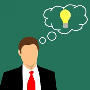 an illustration of a man with a thought bubble with a lightbulb enclosed in it.