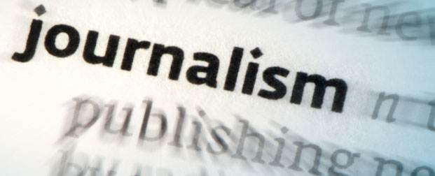 A newspaper print of the word journalism