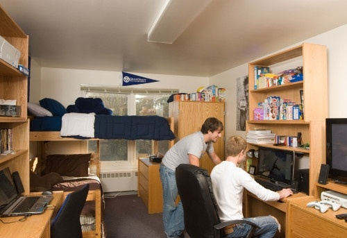 People in a dorm room.