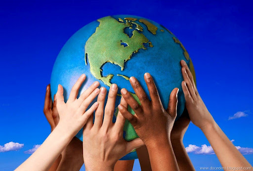 picture of hands holding up a globe together