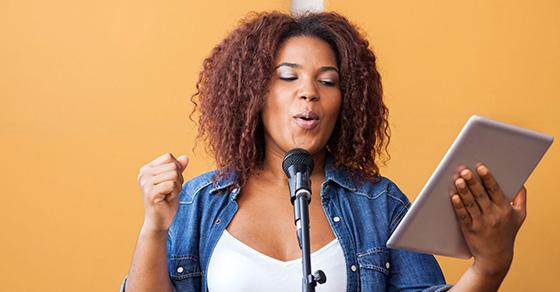 A woman singing song lyrics.