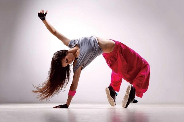 A dancer breakdancing