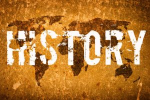 "Image of the word ""History"" overlaying an aged map"