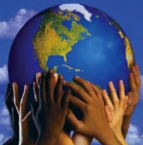 Picture of many hands holding up a globe