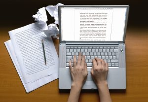 A student rewriting an essay for better result