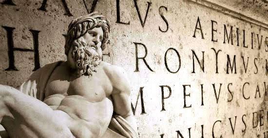 A sculpture over Latin writing