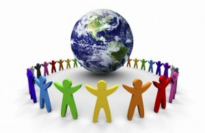 Image of multicolored human figures standing in a circle around a globe