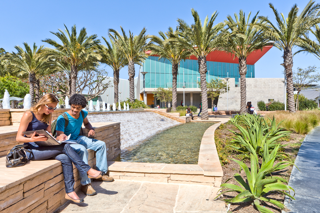 Santa Monica College students sitting and enjoying the weather while reading