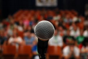 An image of a microphone associated with public speaking