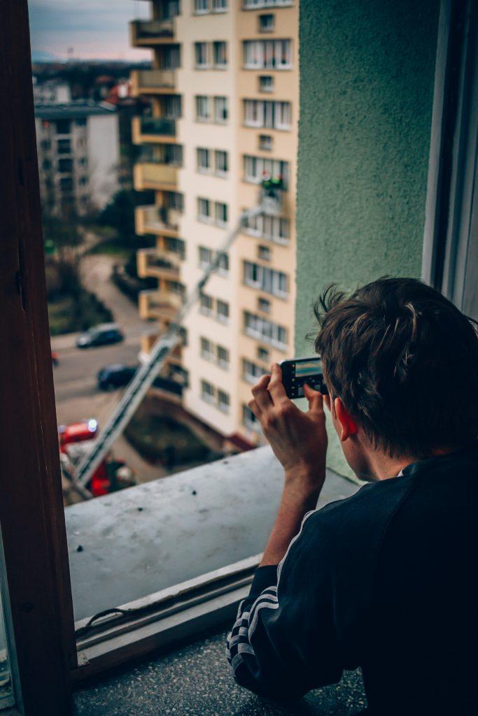 Man taking photo of fire rescue, via Nick Cooper on Unsplash