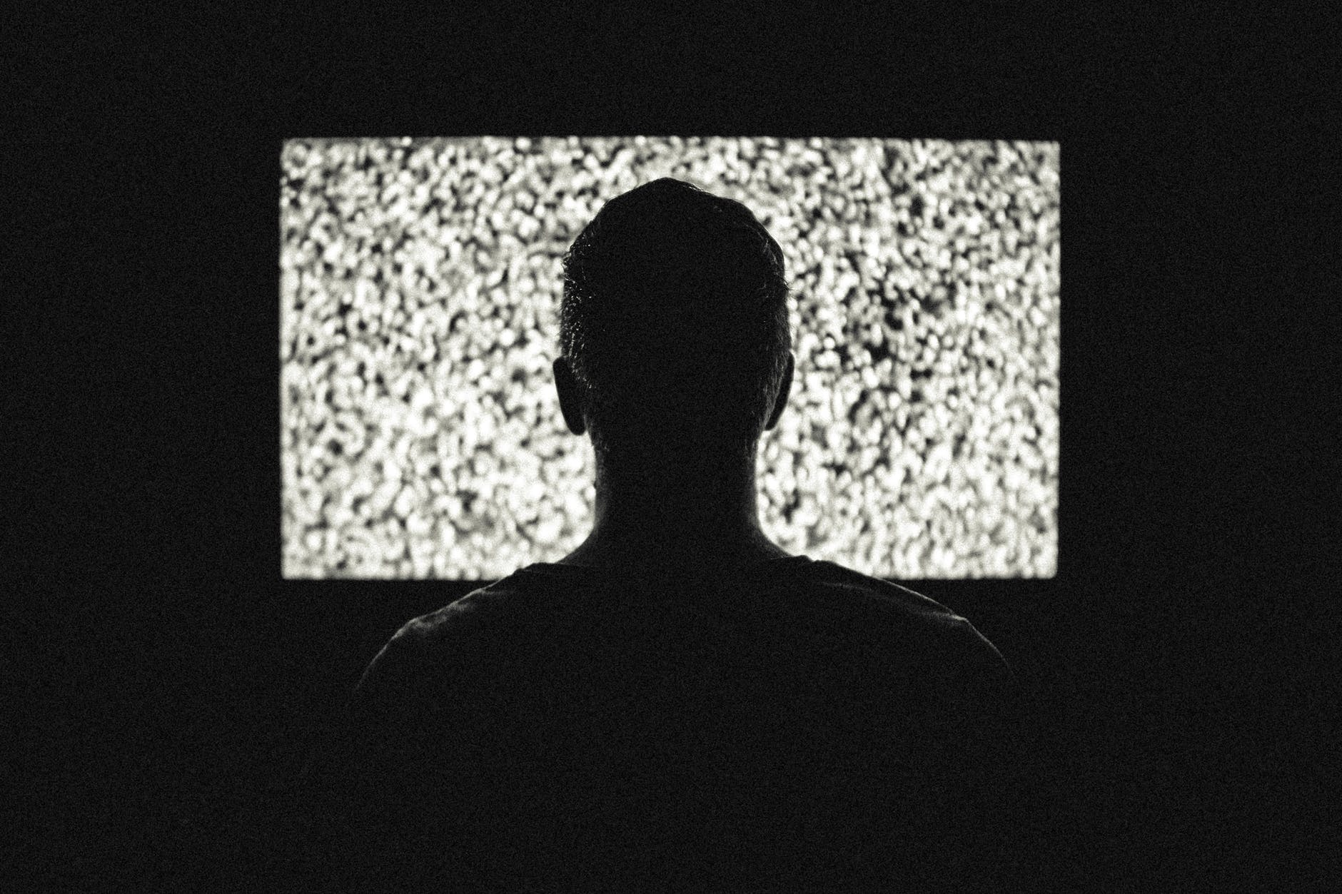 Person watching TV at night