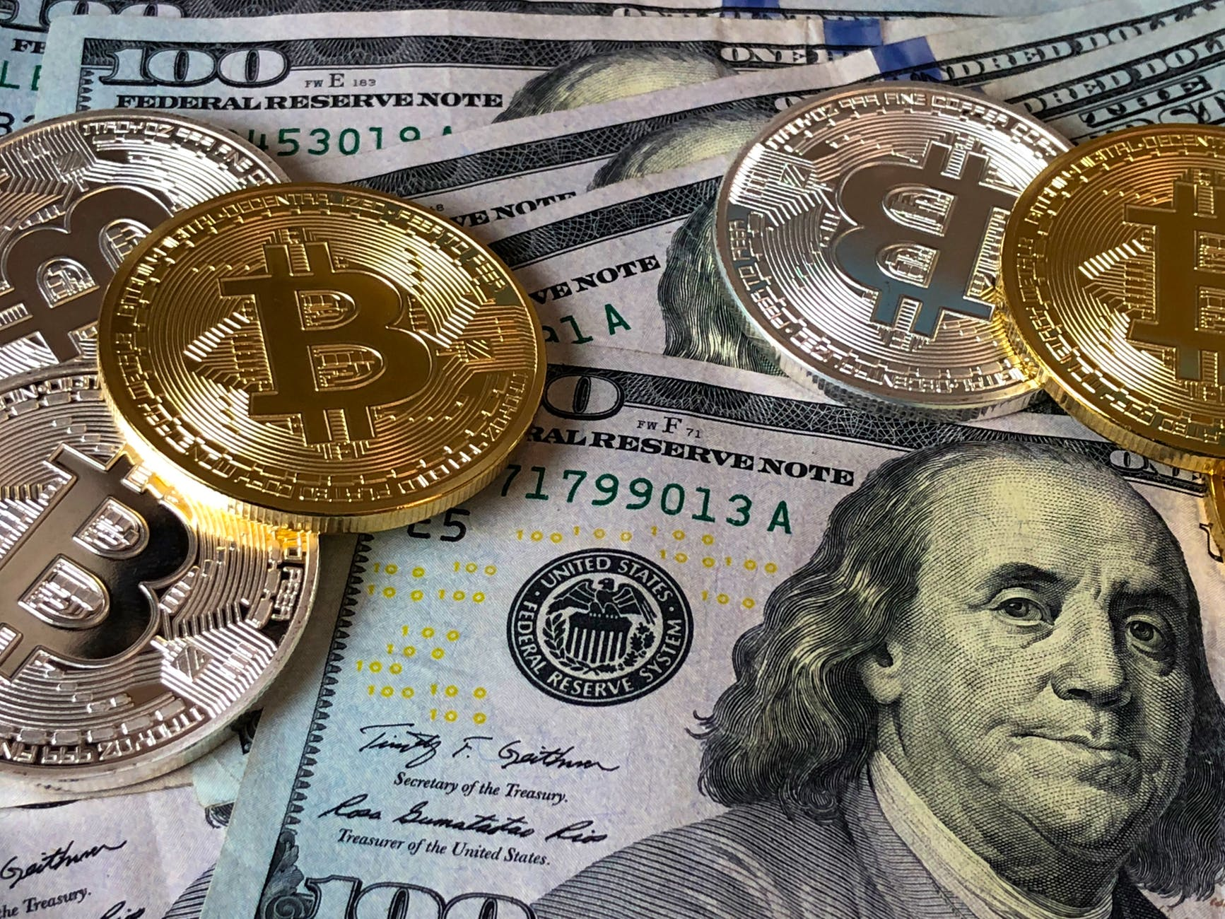 Bitcoin currency and american hundred dollar bills