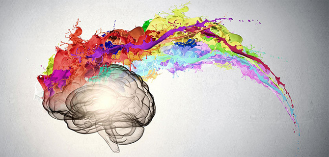 Drawing of a brain with colorful paint splatter coming out of it.