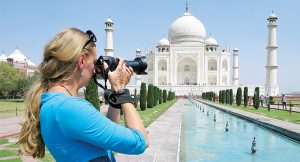A tourist taking a photo of a building.