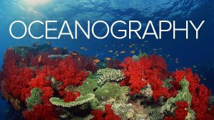 """The word """"Oceanography"""" with reefs in the background"""
