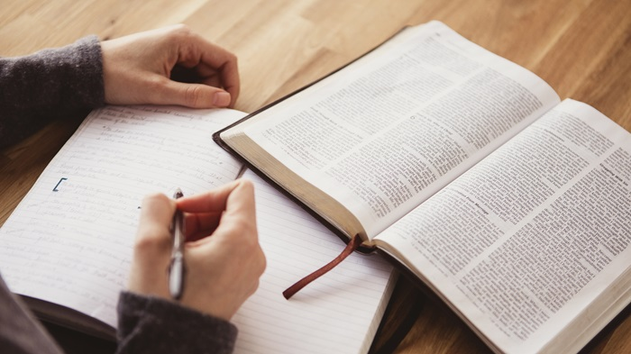 This image is of a student studying the Bible.