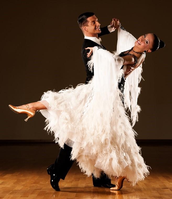 Professional ballroom dancing couple doing the foxtrot.