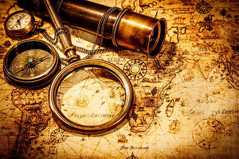 A map and a magnifying glass