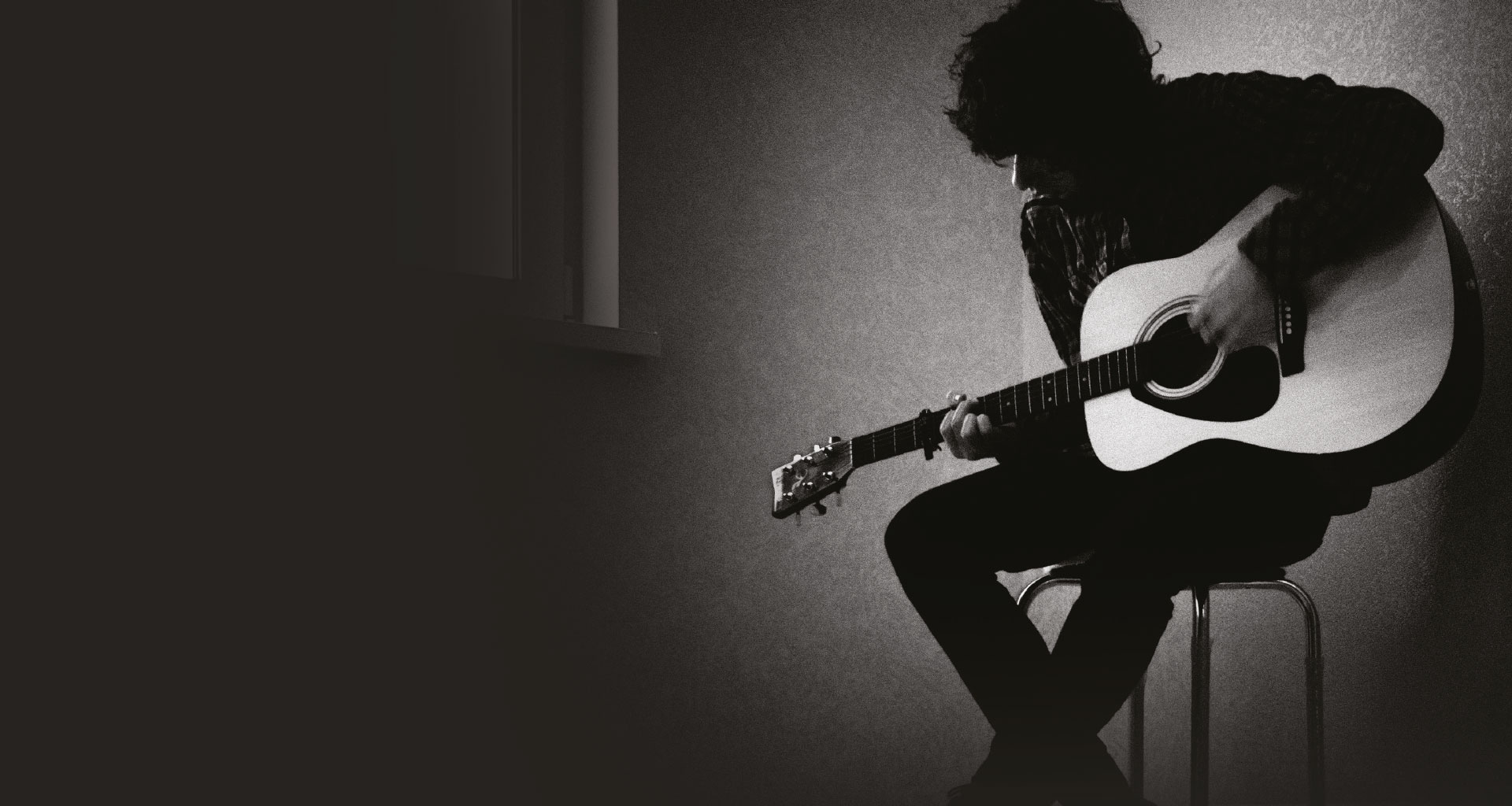 A man playing the guitar.
