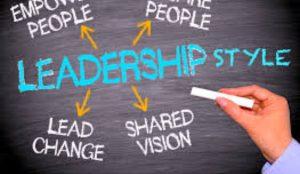 Leadership styles written out on a chalkboard.