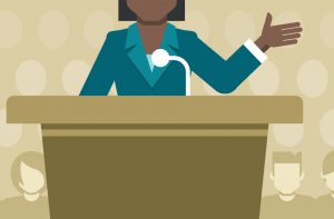Clipart image of woman speaking at a podium.