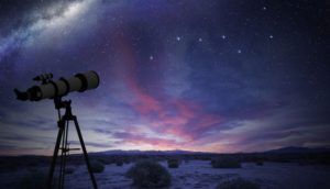 A telescope looking up at the night sky.
