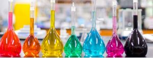 An image of chemicals and tools used in chemistry labs.