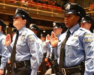 An image of police officers taking an oath.