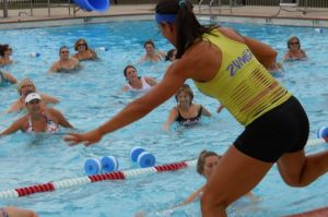 An image of people learning Zumba in the water.