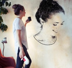 A lady drew herself on a wall using spray paint