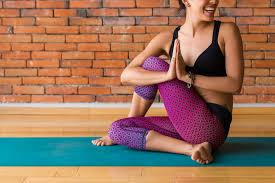 This image is of a student enjoying a specific yoga pose.
