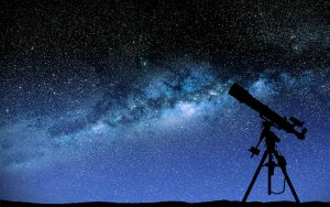 A telescope pointing to the night sky.