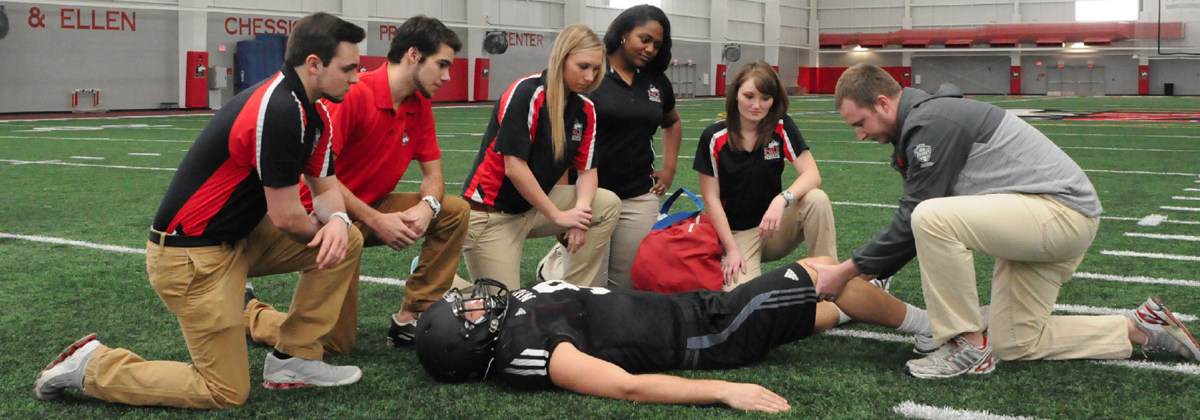 This image demonstrates students practice athletic training.