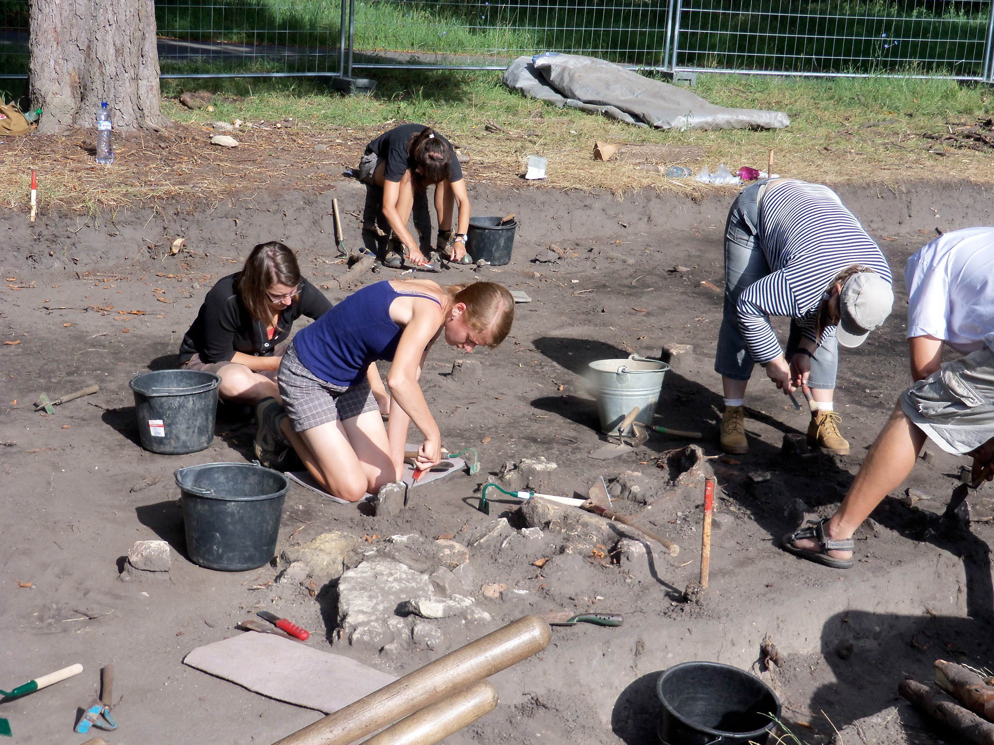 This image captures students digging at an archeological site.