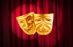 Drama and comedy masks in front of a curtain