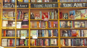 A book shelf full of young adult books