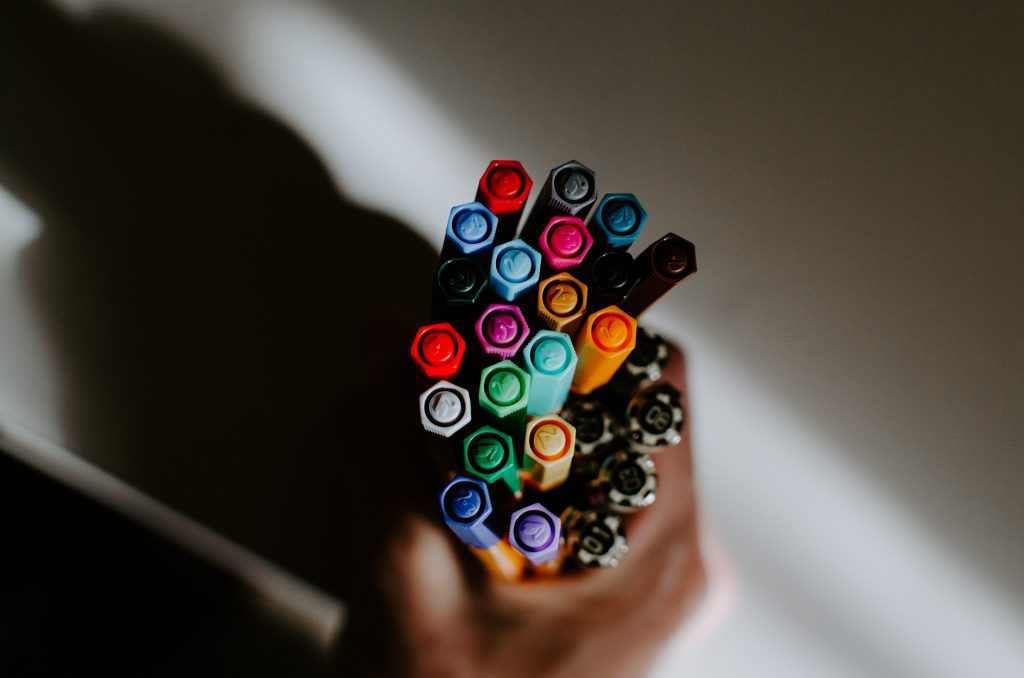 A bird's eye shot of a pencil cup filled with markers.