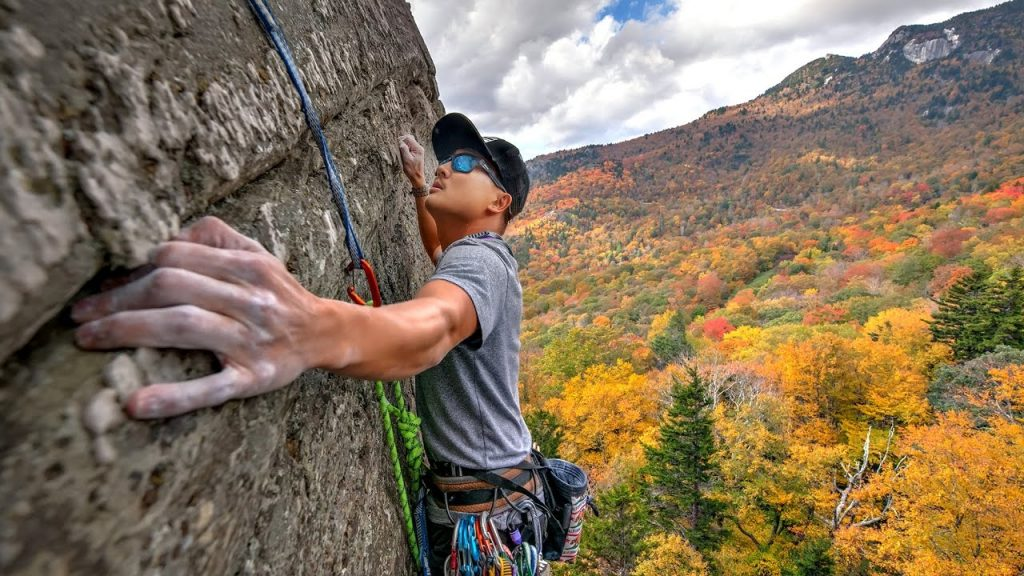 A man climbing the wall of a mountain.