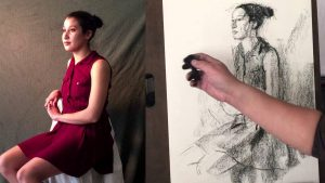 A guy drawing his clothed model