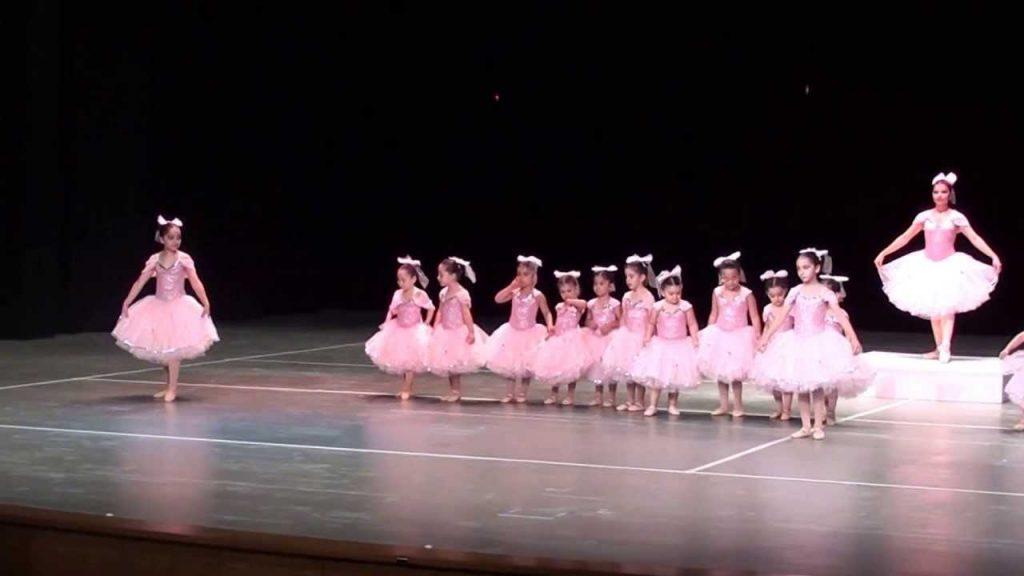 Little ballerinas dancing on stage.