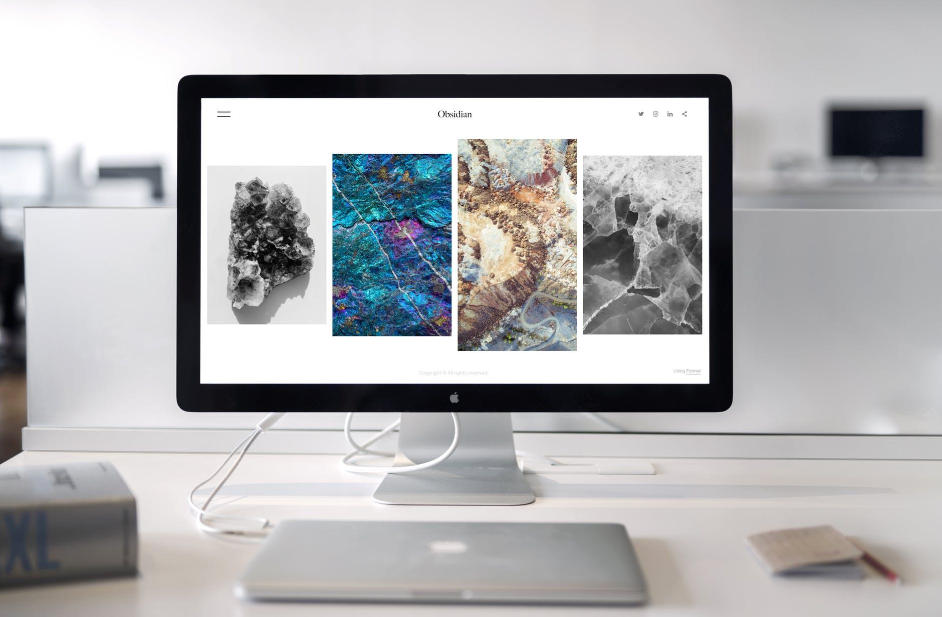 Photo of iMac near Macbook