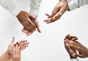 hands of different ethnicities clapping