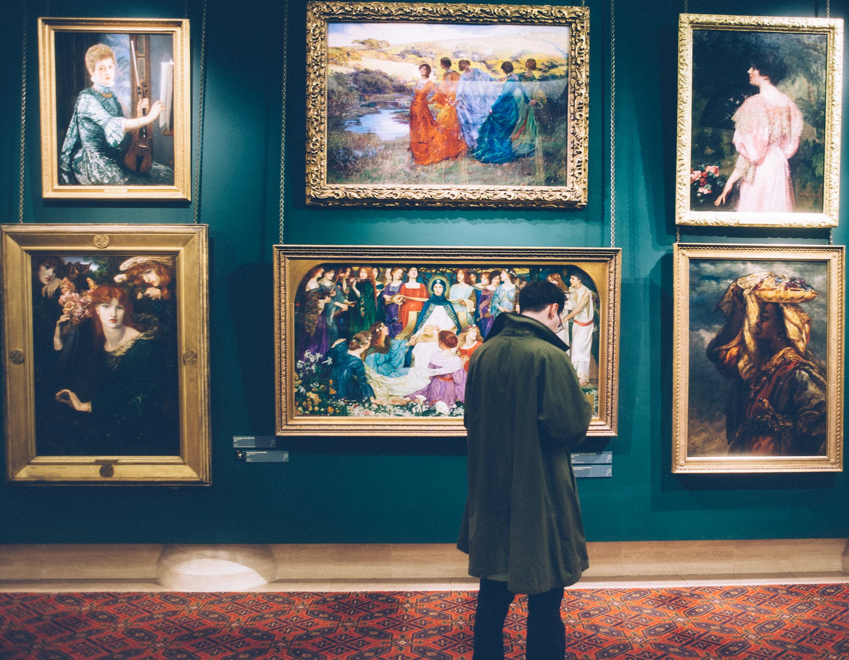 A man looking at historical art work
