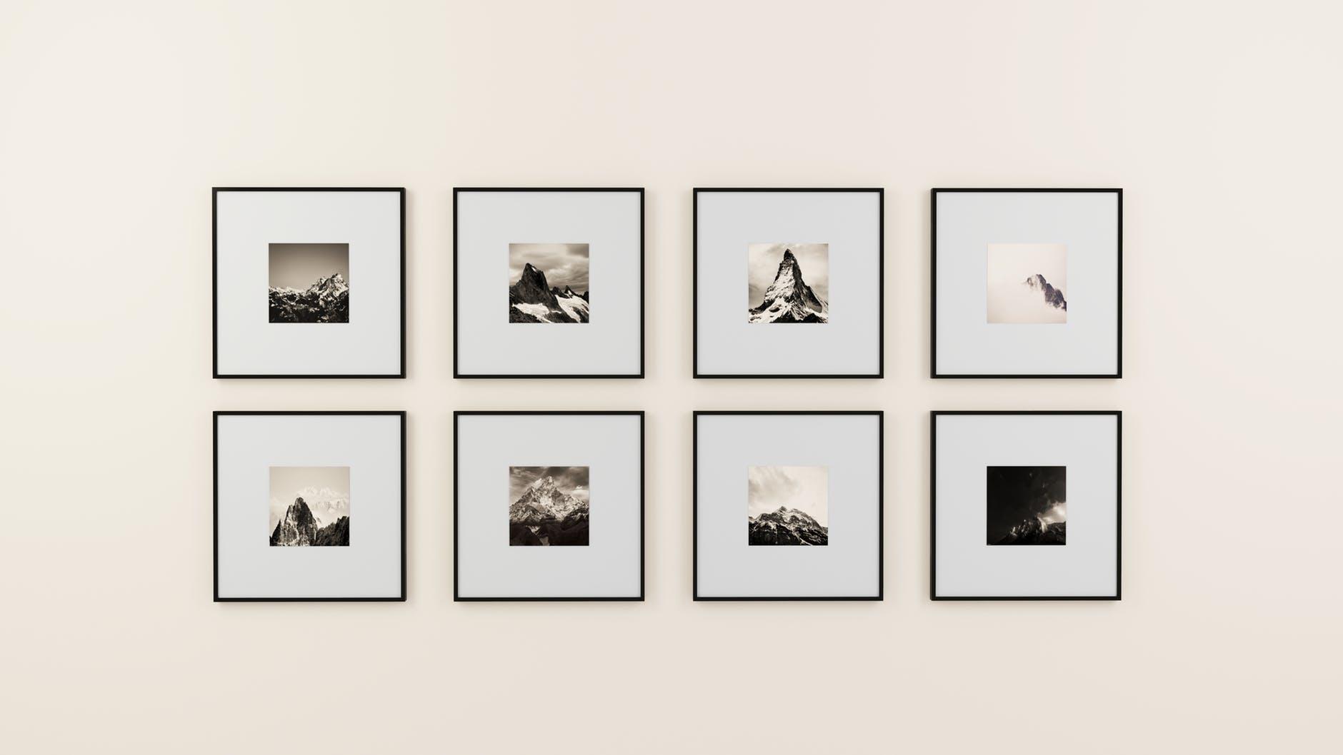 Framed photographs on a blank wall