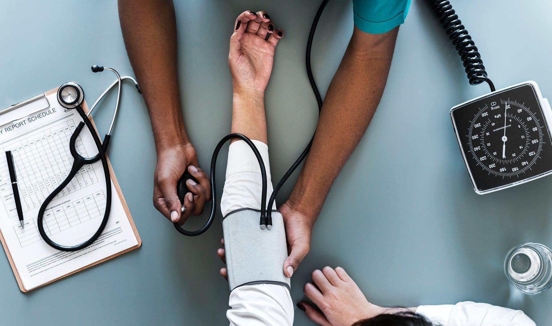 A nurse taking a patient's blood pressure.