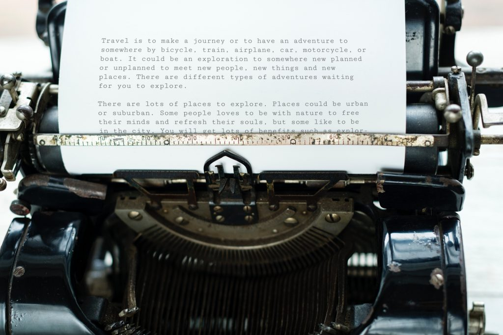 an essay on travel being written on a typewriter.