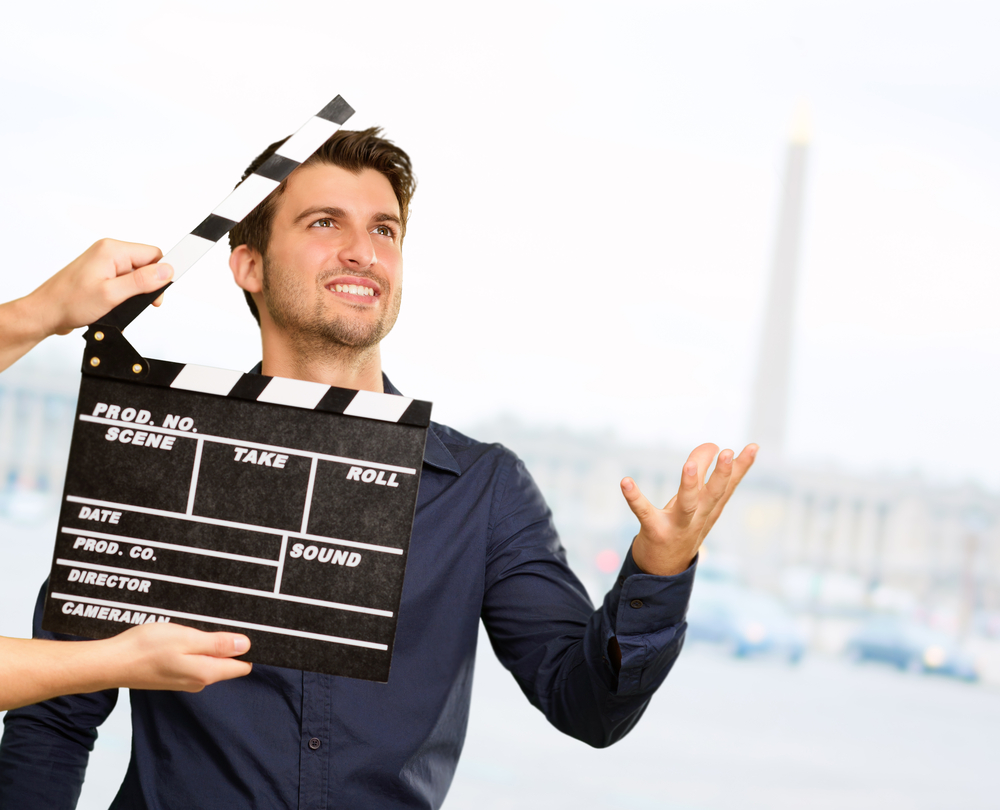 Man preparing to act in front of a clapboard