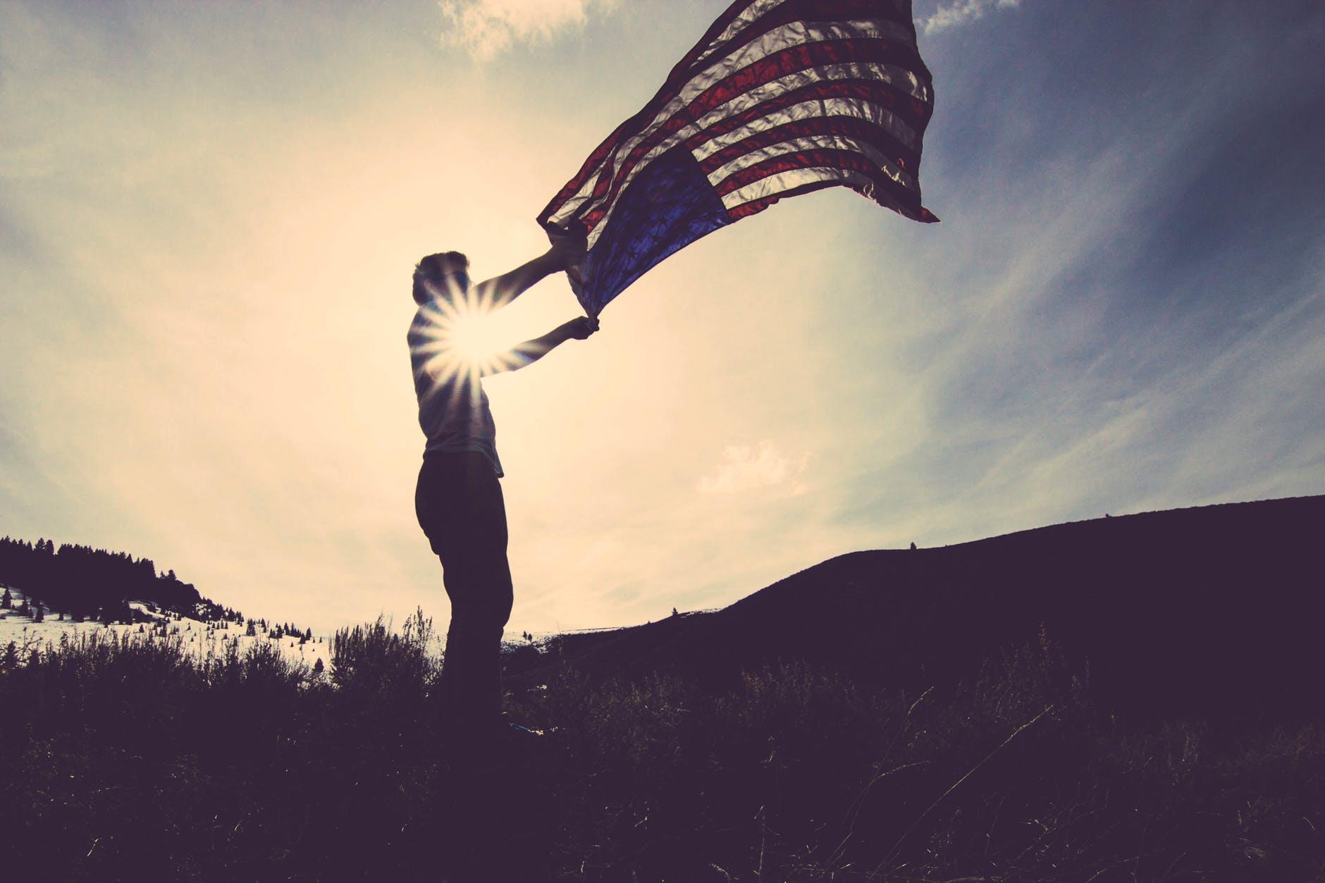 A man holding a U.S. flag