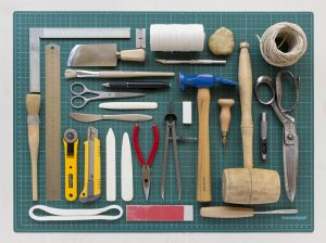 The tools needed for bookbinding